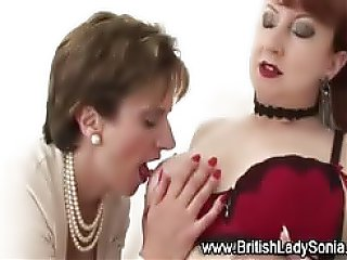Sexy Lady Sonia gets her tits and pussy licked softly by this red head mature lesbian...