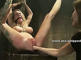 Kinky dirty lesbian uses her basement to fuck tied victims licking them hard in bondage sex video