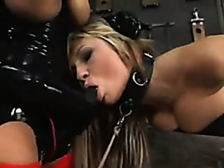 Bondage girl takes strapon cock