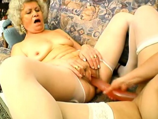 Old granny is getting her cunny toy fucked by her lesbian lover